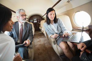 Customers use laptop in Gulfstream jet